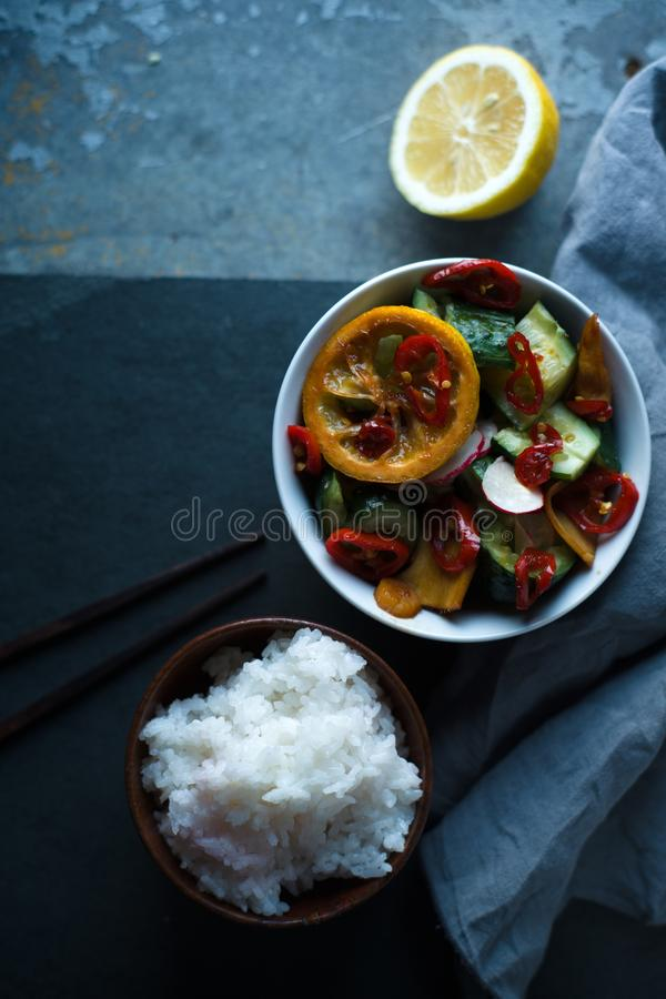 Rice and pickled vegetables to make sushi free space. Asian cuisine. Vertical stock photography
