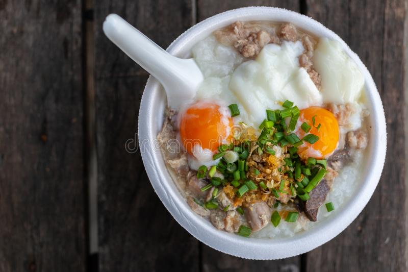 Rice porridge with pork chops and boiled egg stock photography