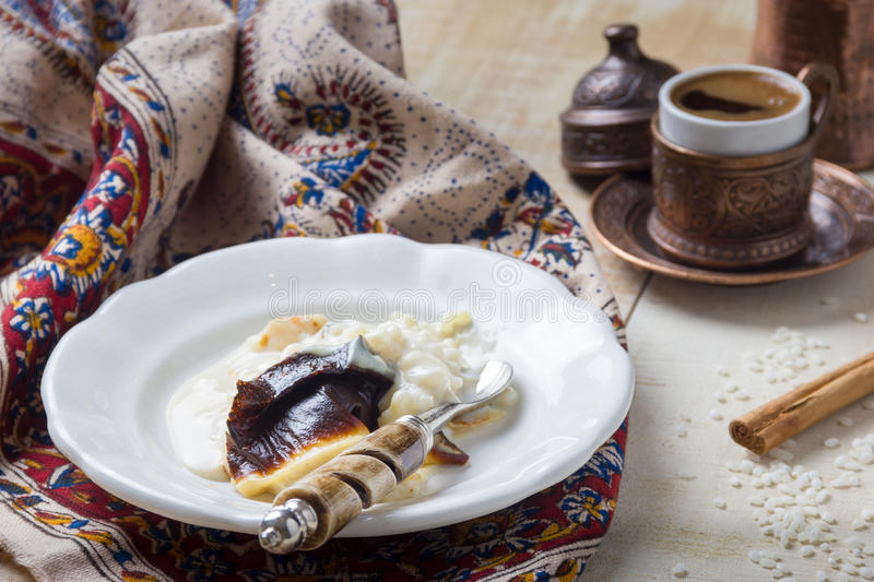 Rice Pudding Dessert. Sutlac with coffe stock photography