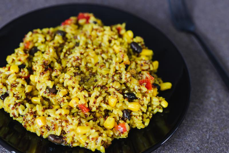 Rice and quinoa mix with beans and corn with turmeric and spices royalty free stock images