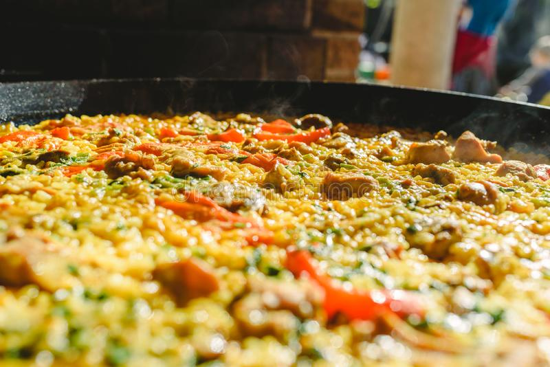 Rice and rabbit, typical dish of the gastronomy of the region of Murcia, Spain, cooked in a paella pan.  royalty free stock image
