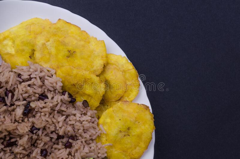 Rice with red beans and tostones royalty free stock image