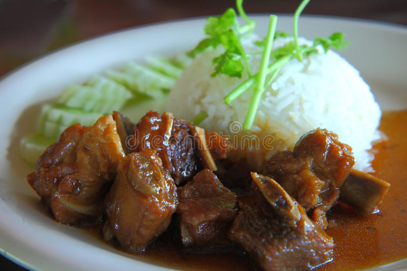 Rice with roasted pork spareribs. Plate of rice with roasted pork spareribs royalty free stock image