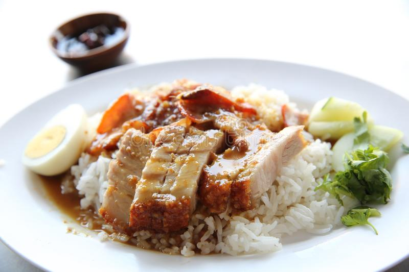 Rice roasted red pork. On a plate royalty free stock photo