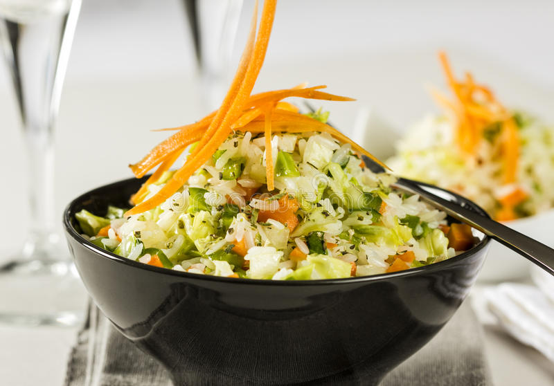 Rice salad with vegetables royalty free stock images