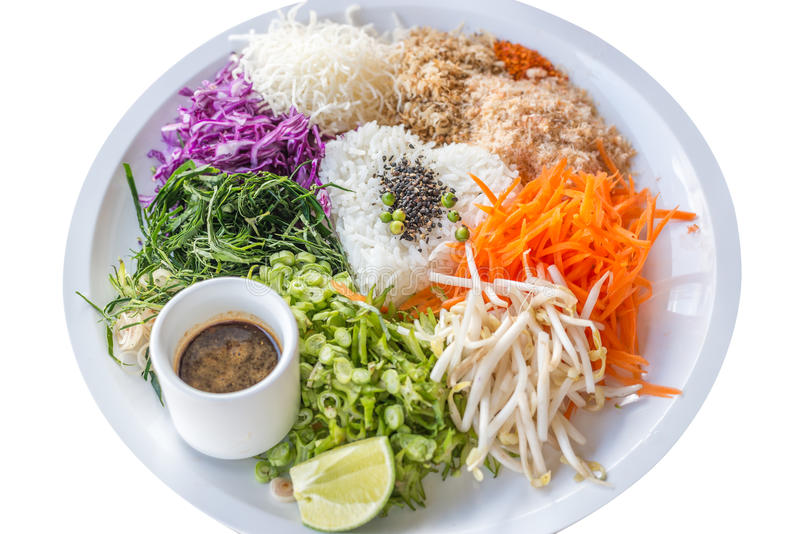 Rice salad on white plate on white background; Khao yam stock photography