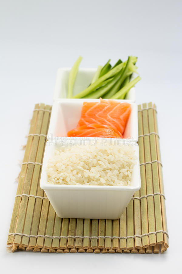 Download Rice Salmon And Sliced Cucumber In White Dish On Bamboo Mat Stock Photo - Image: 34493908