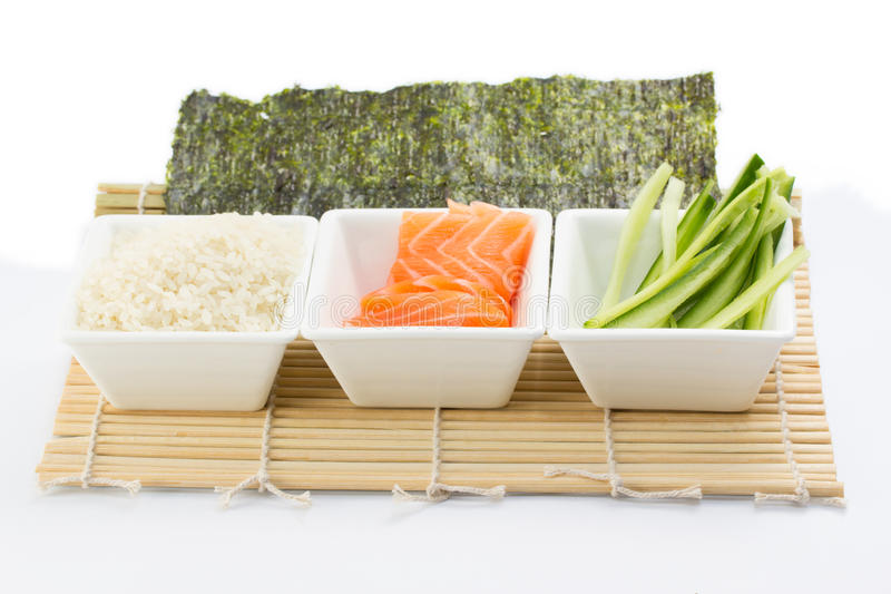 Download Rice Salmon And Sliced Cucumber In White Dish With Nori On Bamboo Mat Stock Photo - Image: 34493892