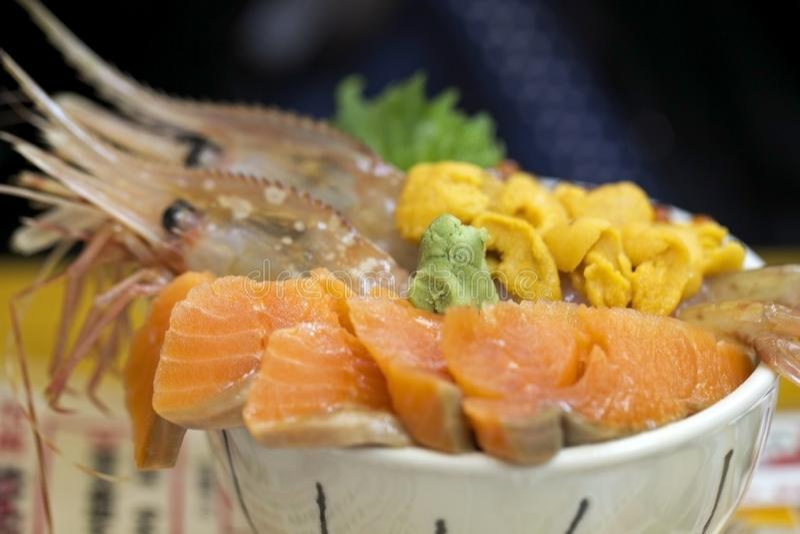Rice with sashimi raw fish stock images
