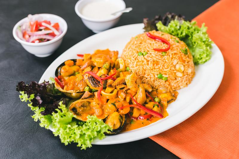 rice with seafood, peruvian sauce and garlic sauce royalty free stock image