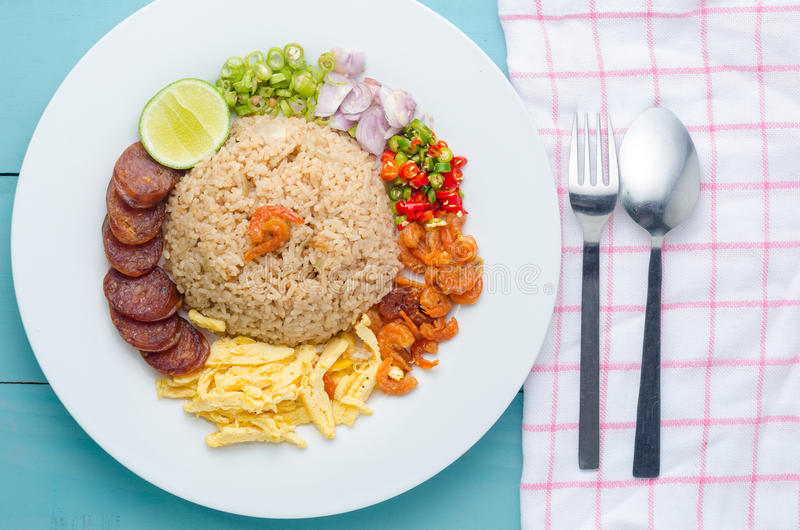 Rice Seasoned with Shrimp Paste, Thai food on white dish over da stock image