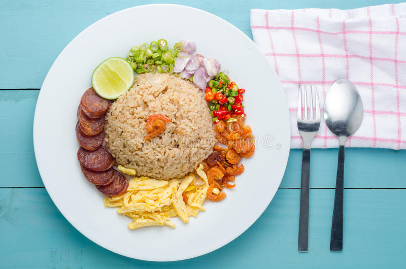 Rice Seasoned with Shrimp Paste, Thai food on white dish over wooden table. stock photography