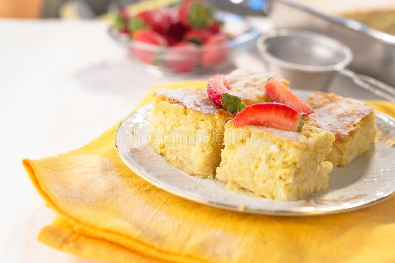 Rice Souffle With Plums In Glass Pan Stock Photo - Image ...