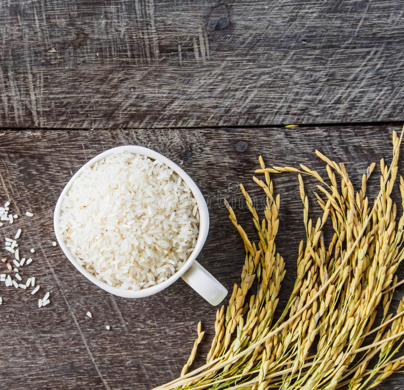 Rice and spike of top view on wooden background stock photos