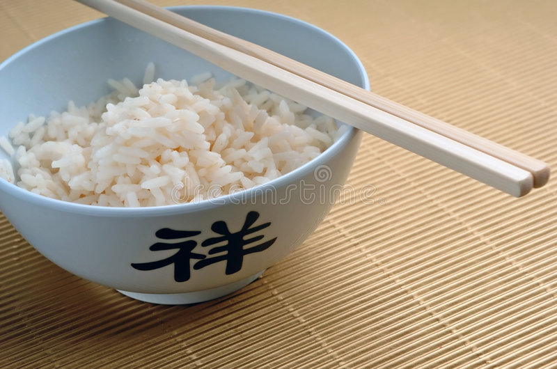 Rice and sticks, cropped royalty free stock photography