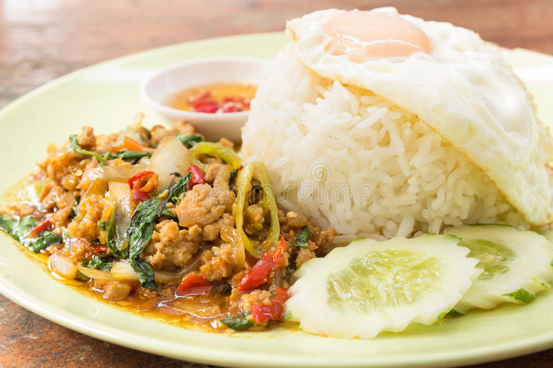 Rice topped with stir fried minced pork and holy basil royalty free stock photo