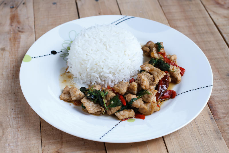 Rice topped with stir-fried pork and basil royalty free stock photos