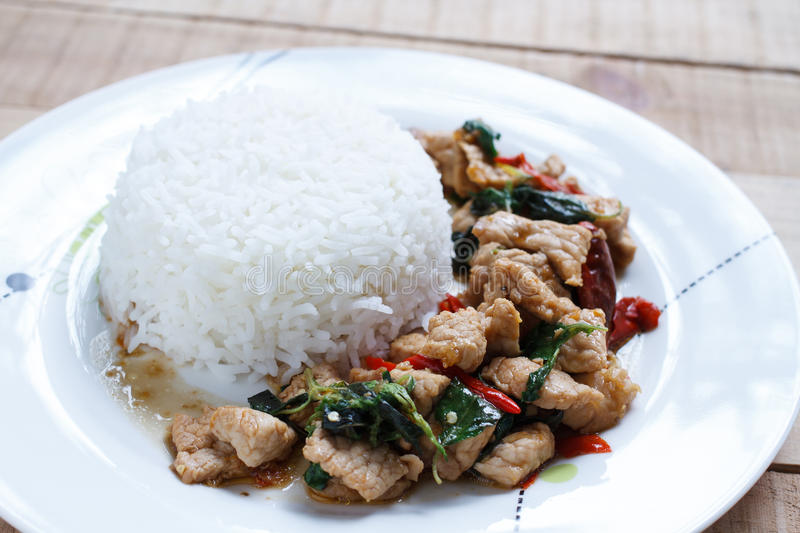 Rice topped with stir-fried pork and basil stock photography
