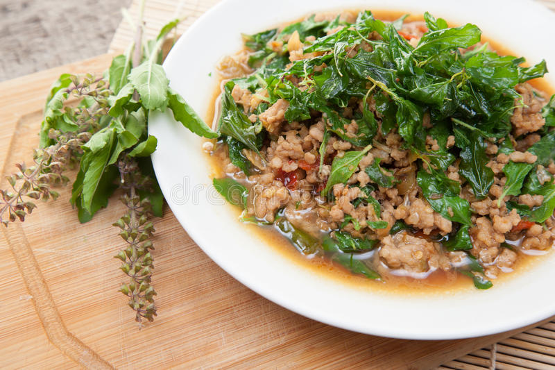 Rice topped with stir-fried pork and basil. Thai food stock photography