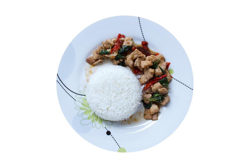 Rice topped with stir-fried pork and basil royalty free stock image