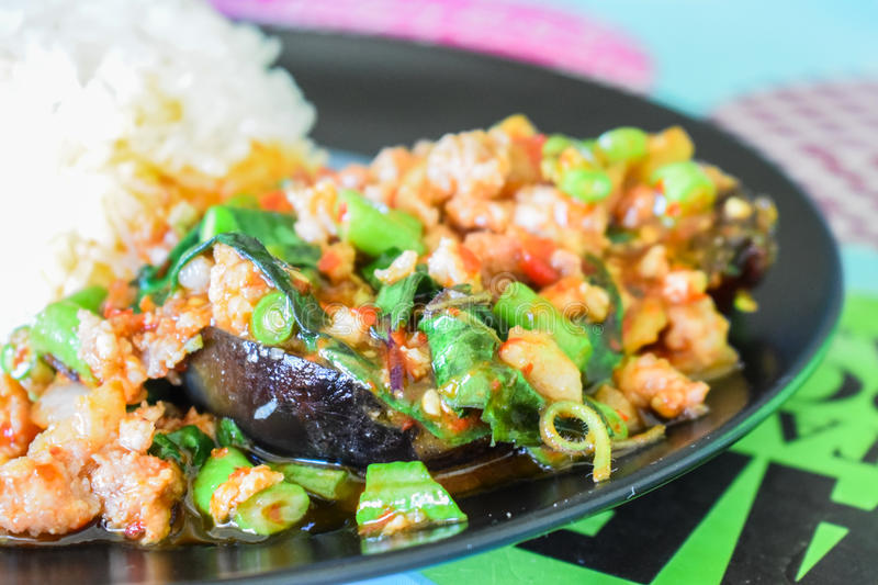 Rice topped with stir-fried pork, Century egg and basil. Season with seasoning oil sauce fish sauce sugar basil leaves,Scoop on rice, Eat with eggs And chili stock image