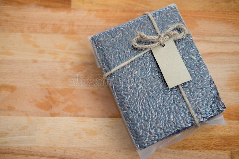 Rice in vacuum package. On wood table stock photography