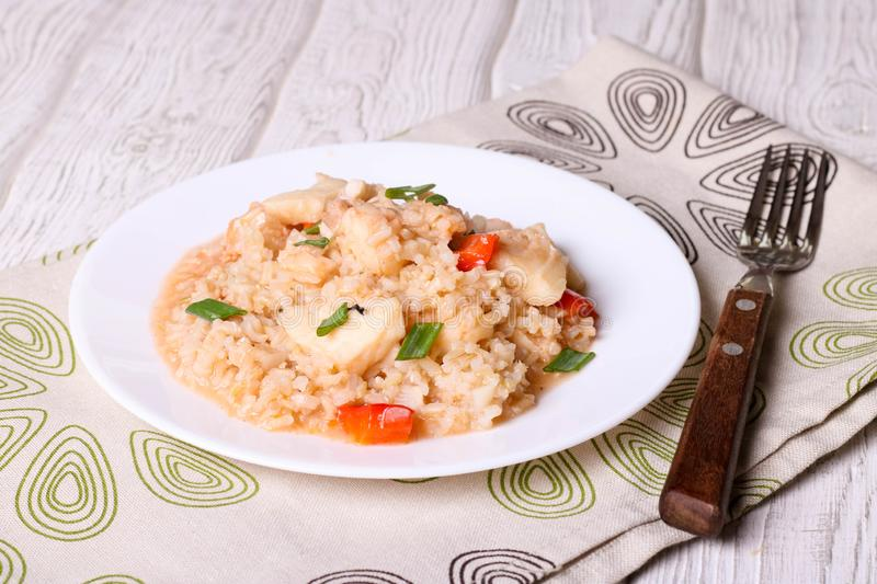 Rice with vegetables and fish stock image
