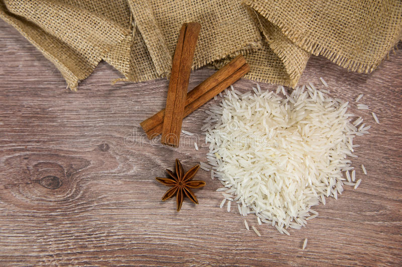 Rice on wood with cinnamon sticks royalty free stock photo