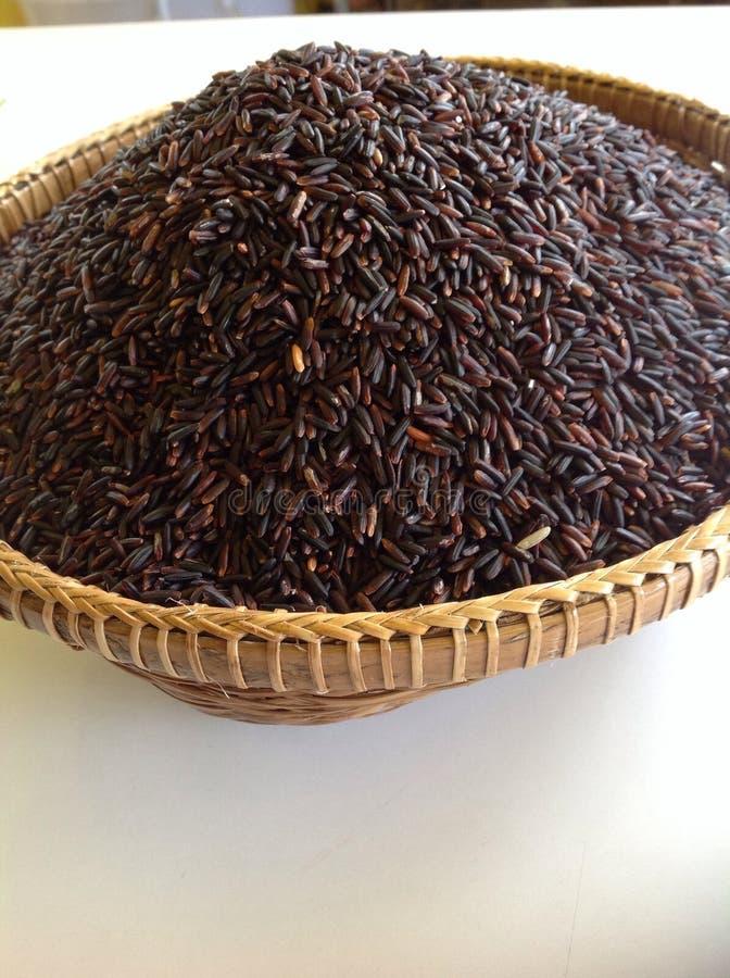 Riceberry in bamboemand royalty-vrije stock fotografie