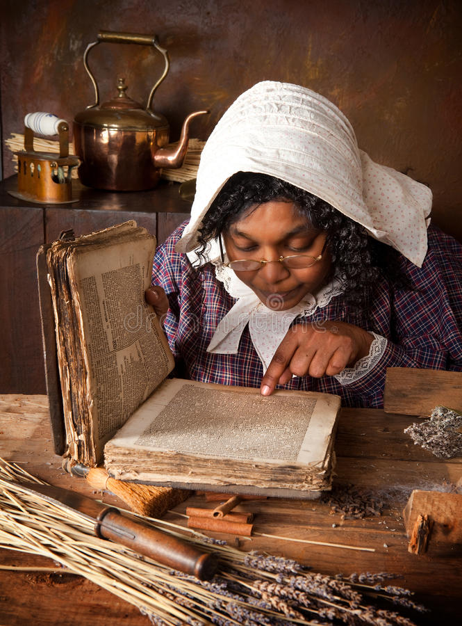 Ricetta della lettura della donna dell'erba dell'annata immagine stock