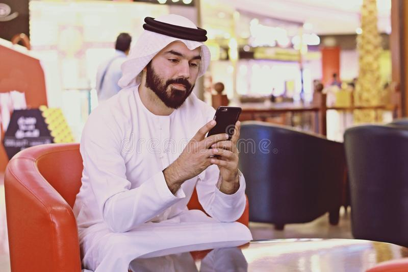 Rich Arab Business Man Using Internet Mobile Phone In Cafe Shop royalty free stock photography