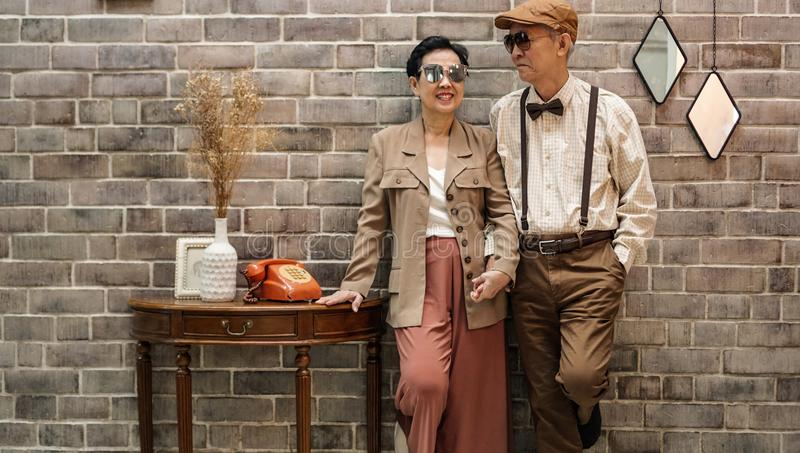 Rich Asian senior couple vintage fashion in luxury house royalty free stock photo