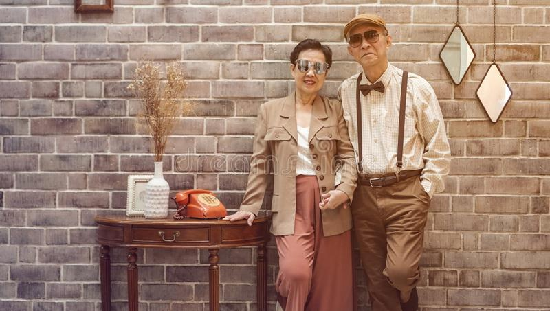 Rich Asian senior couple vintage fashion in luxury house stock photo