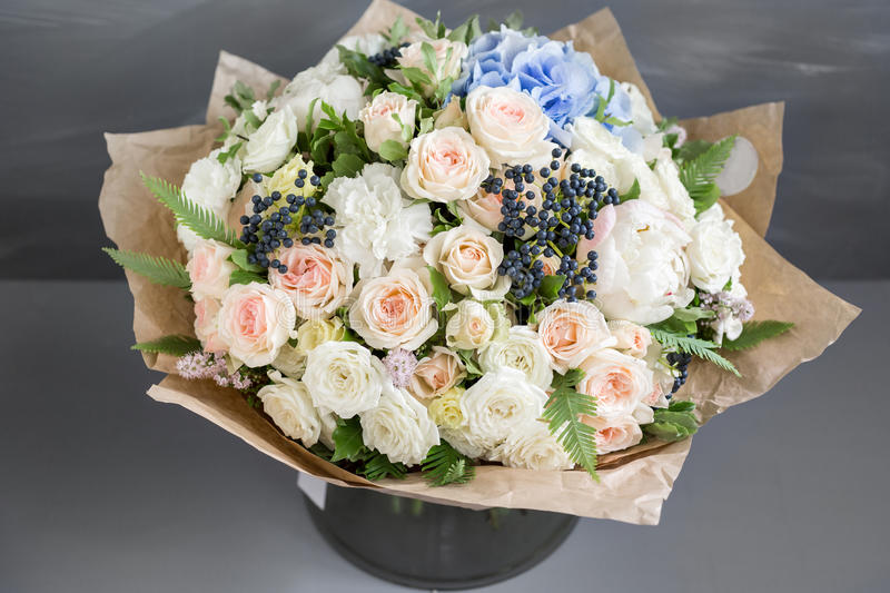 Rich bunch of peonies, roses and hydrangea flowers, green leaf. Fresh spring bouquet. Summer Background. Selective focus stock photos