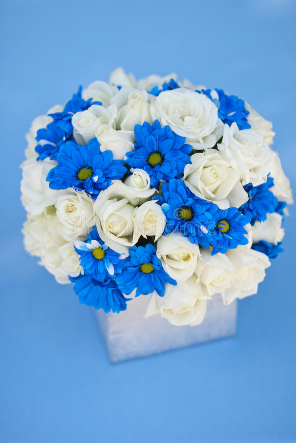 Rich Bunch Of White Roses And Blue Flowers In Glass Vase Stock
