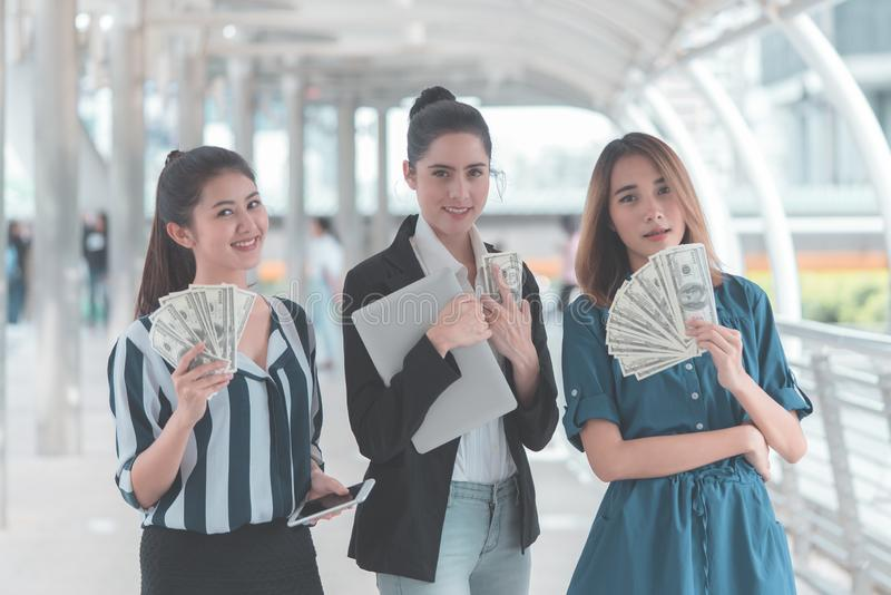 Business women counting money cash in their hand royalty free stock image