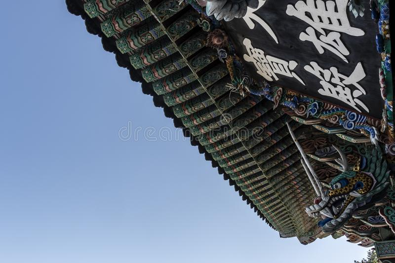 Rich decorated roof of the Haedong Yonggungsa buddhist monastery in Busan, South Korea. Asia stock images