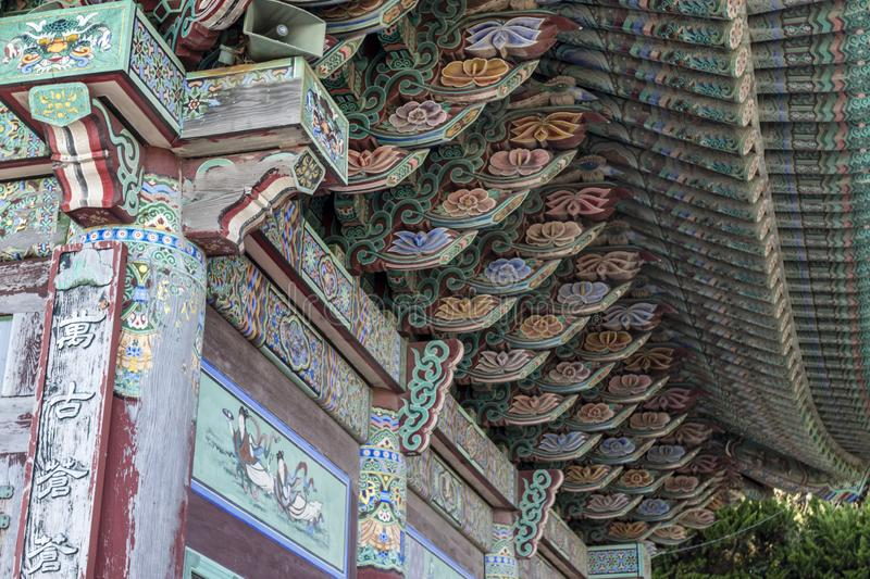 Rich decorated roof of the Haedong Yonggungsa buddhist monastery in Busan, South Korea stock photo