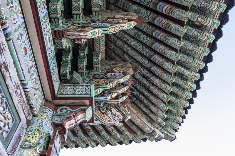 Rich decorated roof of the Haedong Yonggungsa buddhist monastery in Busan, South Korea royalty free stock photo