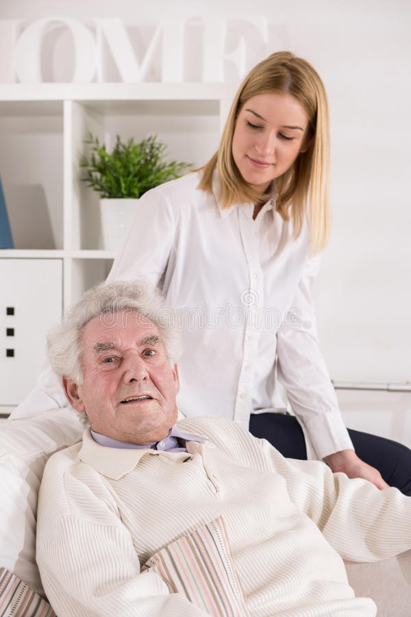 Rich elderly man and carer. Picture of rich happy elderly men and his private carer stock photo
