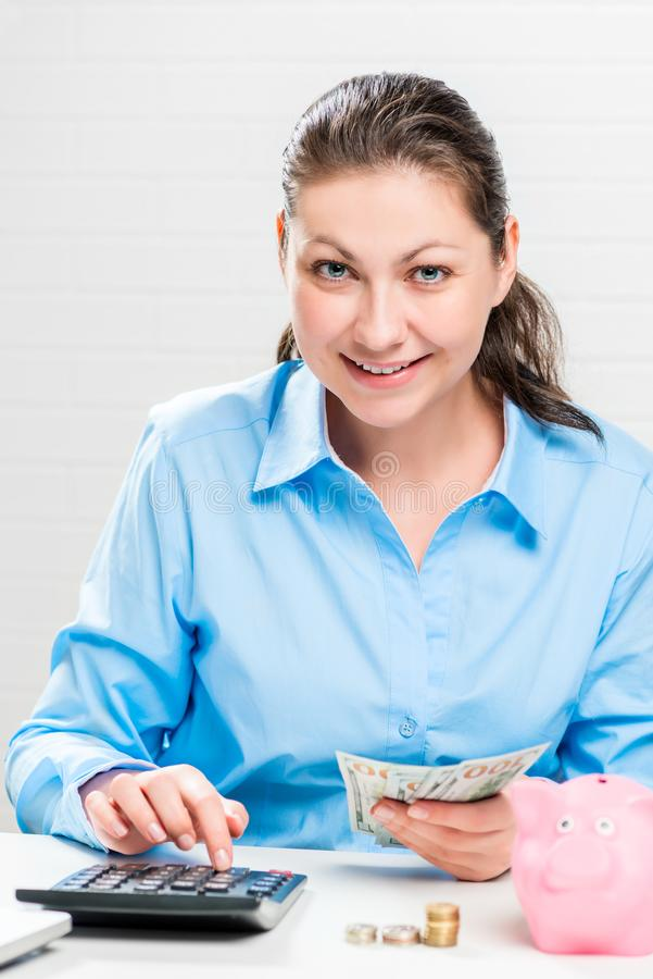 Rich happy businesswoman considers royalty free stock image