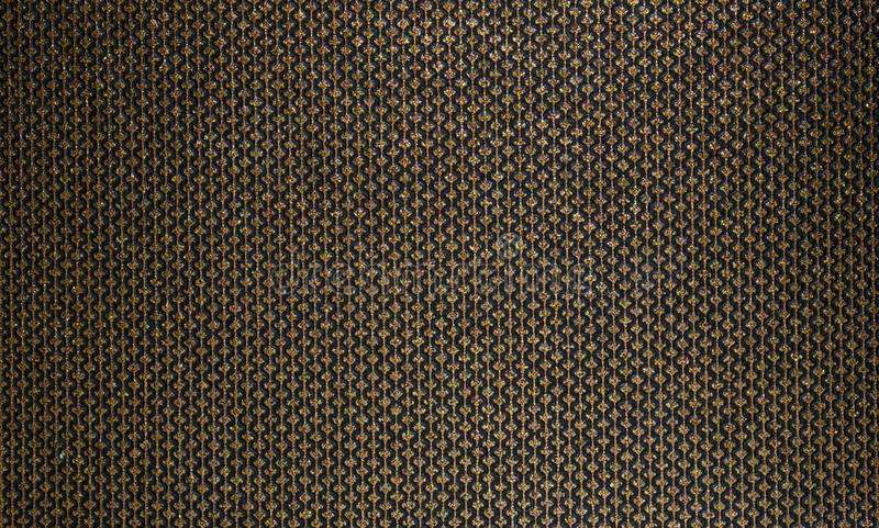 Rich, honey texture for fabric and Wallpaper. Gold lines patterns with diamonds on a black background stock photo