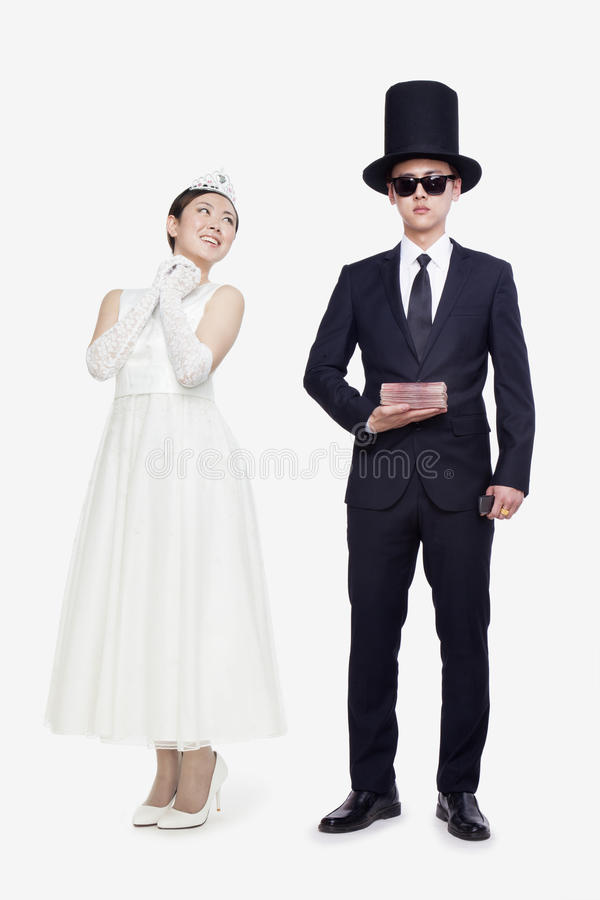 Rich Man and princess, opposite, studio shot royalty free stock images