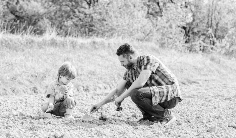 Rich natural soil. Eco farm. happy earth day. Family tree. new life. soils and fertilizers. small boy child help father royalty free stock photography