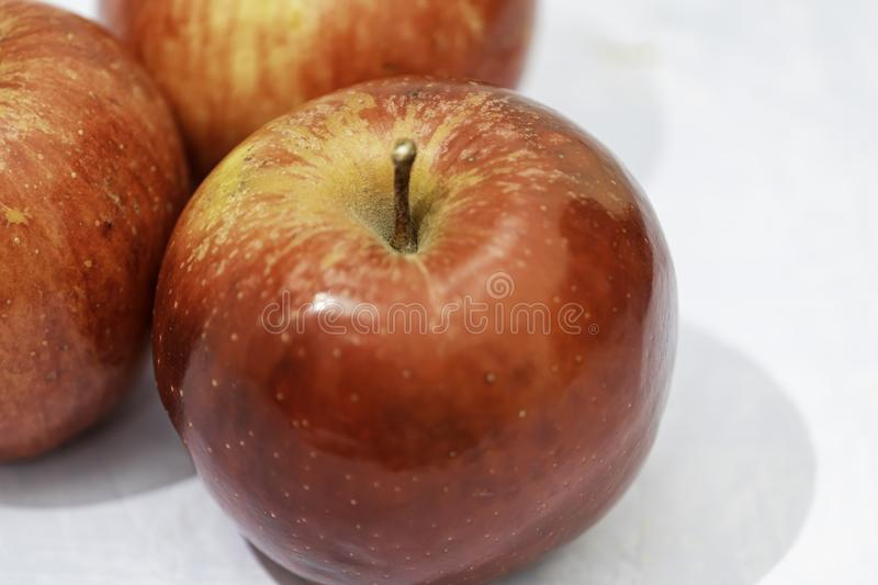 Rich fresh red apples for a natural dessert. Rich and tasty red, juicy and natural apples with many vitamins royalty free stock photo
