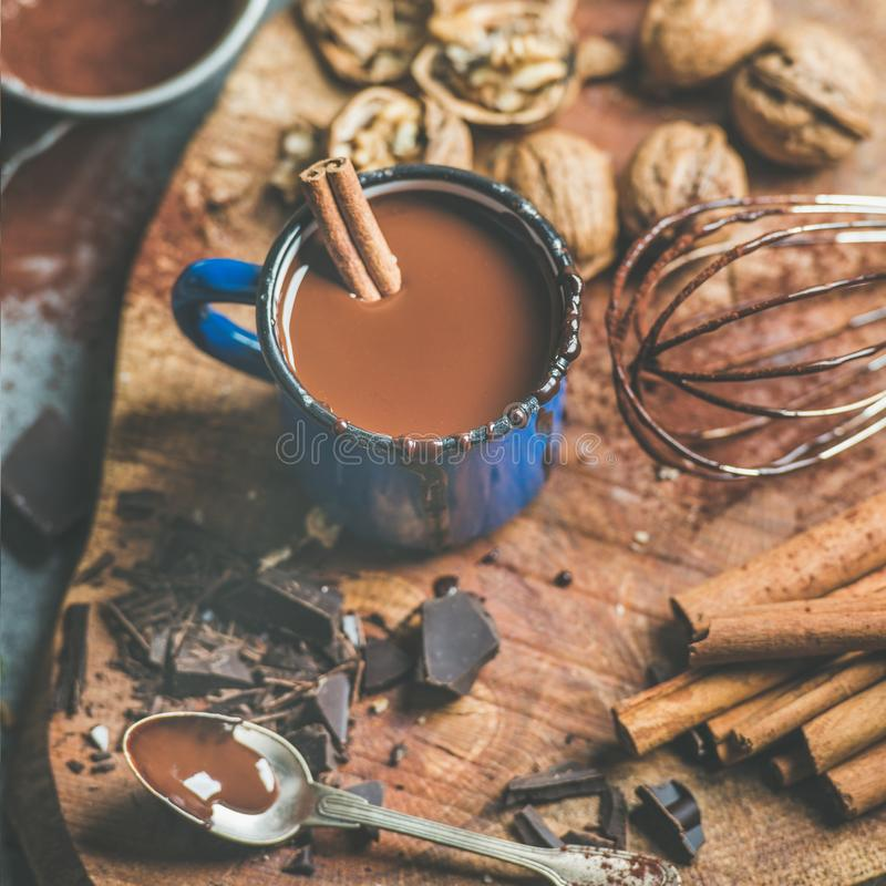 Making rich hot chocolate with cinnamon and walnuts, square crop royalty free stock image