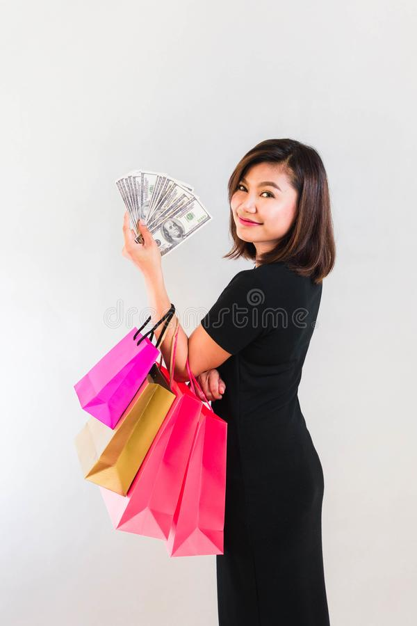 Woman Shopping with Dollar Cash royalty free stock image