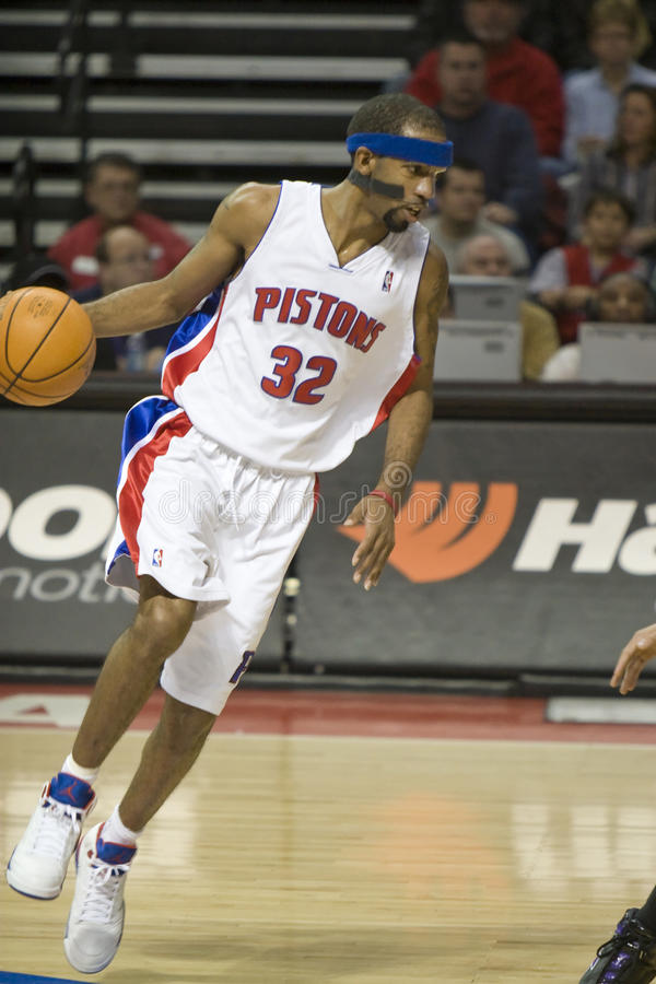 Richard Hamilton With The Ball. Richard Hamilton of the Detroit Pistons looks to drive during a game against the Sacramento Spurs in Auburn Hills stock photography