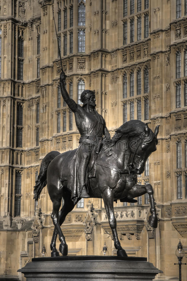 Richard the Lionheart Statue. Closeup of Richard the Lionheart statue with Palace of Westminster in background, London, England stock image