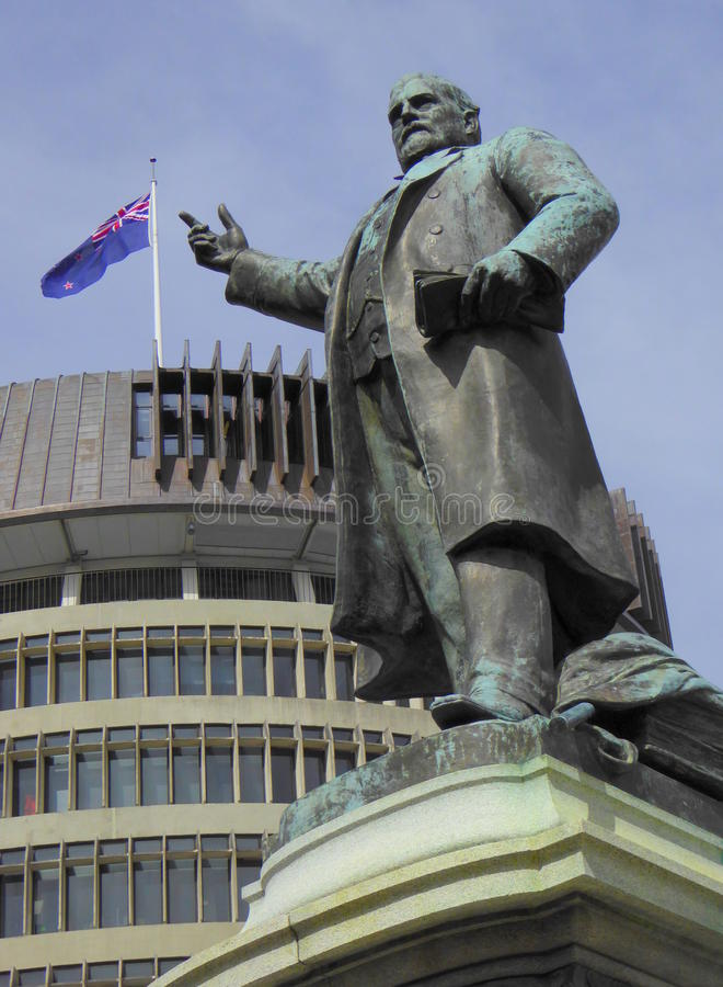 Bronze statue of prime minister pointing to flag. The statue in Wellington of Richard John Seddon 1845-1906, the longest-serving Prime Minister of New Zealand stock image